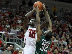 Gorgui Dieng (10) had 10 points and a career-high 16 rebounds to help coach Rick Pitino notch his 250th win at Louisville.