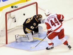 Red Wings right wing Todd Bertuzzi (44) scores the winning goal in a shootout against the Bruins at TD Garden.