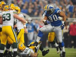 Detroit Lions defensive tackle Ndamukong Suh (90) stomps on Green Bay Packers offensive guard Evan Dietrich-Smith during their game in Detroit.