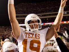 Texas kicker Justin Tucker celebrates with teammates after hitting the game-winning field goal as time expired in College Station, Texas on Thursday.