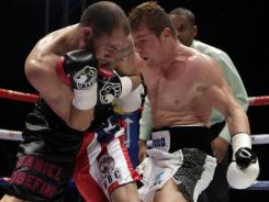"Saul ""Canelo"" Alvarez,  right,  scored a fifth-round technical knockout of  Kermit Cintron, to retain his WBC light middleweight belt in Mexico City."