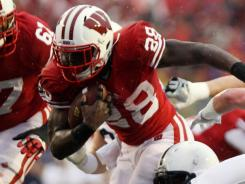 Montee Ball rushed for 156 yards and four touchdowns to lead Wisconsin into the inaugural Big Ten championship game.