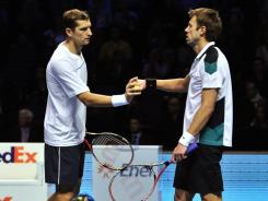 Max Mirnyi of Belarus, left, and Daniel Nestor of Canada knock out top-ranked Bob and Mike Bryan.