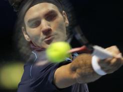 Roger Federer of Switzerland tops David Ferrer of Spain to reach the final at the ATP's season-ending championships.