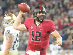 Andrew Luck threw four touchdown passes, giving him a Stanford-record 80 in his three-year career.