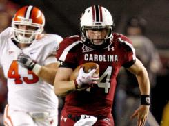 Connor Shaw (14) threw for three touchdowns and ran for another to secure the second 10-win season in South Carolina's 118-year history.