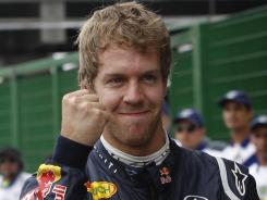Germany's Sebastian Vettel reacts after taking the pole position for the Brazilian Grand Prix in Sao Paulo. The final race of the Formula One season will be held Sunday.