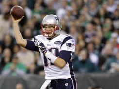 Tom Brady guided the  Patriots past the Eagles with three touchdown passes Sunday.