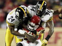 Ike Taylor (24), Lawrence Timmons (94) and the Steelers defense forced four turnovers in their win over the floundering Chiefs.