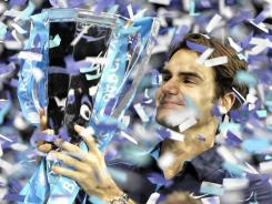 Roger Federer caps his 2011 season with a victory, and confetti, at the ATP World Tour Finals in London.