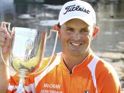 Australia's Greg Chalmers holds the trophy after winning the Australian PGA Golf Championship at the Hyatt Regency in Coolum, Australia.