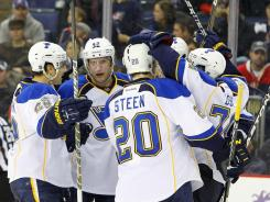 Blues players celebrate David Backes' power-play goal in the third period, which broke a 1-1 deadlock and lifted the Blues to their third consecutive win.