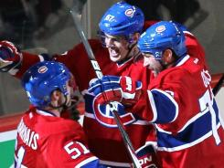 Montreal's Max Pacioretty, center, had a goal and an assist in Saturday's game but also landed a three-game suspension for a head hit.
