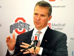 Urban Meyer agreed to a six-year contract with Ohio State worth $4 million annually with retention bonuses for 2014, 2016 and 2018.