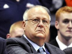 Could the allegations against former Syracuse basketball assistant Bernie Fine, here during an early November game, end up costing head coach Jim Boeheim his job?