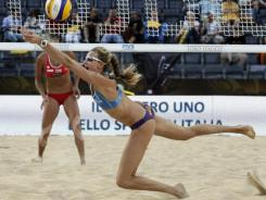 Kerri Walsh, who gave birth to two children and had rotator cuff surgery since winning gold in the 2008 Olympics, hopes she and partner Misty May-Treanor will be at the top of their game in London next year.