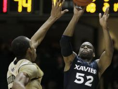 Xavier's Tu Holloway (52) shoots over Vanderbilt's Lance Goulbourne (5) during their matchup on Monday. Holloway led Xavier with 24 points in the team's 82-70 overtime win.