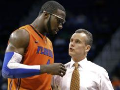 Patric Young, left, talks with coach Billy Donovan during Florida's 96-70 in over Stetson on Monday.   The win was Donovan's  400th career  coaching win.