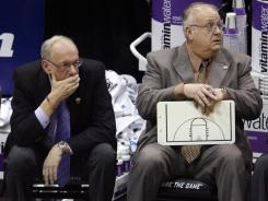 Syracuse coach Jim Boeheim, left, at first vehemently defended associate head basketball coach Bernie Fine before a third man came forward to accuse the long-time assistant coach of sexual assault.