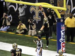 """Saints quarterback Drew Brees came up just short on this attempted dunk over the crossbar after scoring in the third quarter Monday night. """"It turned into a finger roll,"""" he said."""