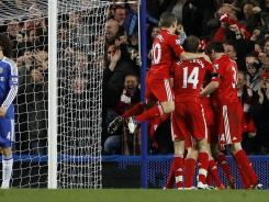 Liverpool celebrates its opening goal in a 2-0 victory over Chelsea during their Carling Cup quarterfinals.