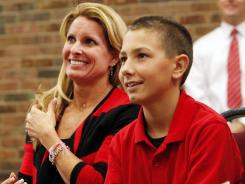 Shelley Meyer sits with her Nathan as her husband is introduced as the new Ohio State football coach.