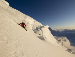 Pro skier Sage Cattabriga-Alosa of The North Face team descends the slopes of Mount Denali in Alaska.