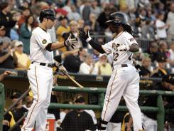 Second baseman Neil Walker, left, 26, and center fielder Andrew McCutchen, right, 25, form the crux of the Pirates' rebuilding efforts on offense.