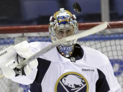Buffalo Sabres goalie Ryan Miller makes a save during practice Wednesday.