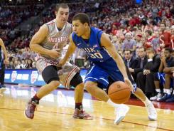 Duke guard Austin Rivers (30) drives around pressure from Ohio State guard Aaron Craft (4) at Value City Arena. Ohio State won the game 85-63.