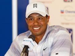Tiger Woods speaks with the media at his news conference ahead of the Chevron World Challenge.