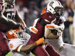 Leader of the sack:  Clemson's Andre Branch brings down South Carolina's Connor Shaw on Nov. 26. Branch is first in the ACC with 10.5 sacks heading into the league title game against Virginia Tech.