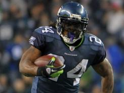 Seattle Seahawks running back Marshawn Lynch scores on a 40-yard touchdown run in the second quarter against the Philadelphia Eagles at CenturyLink Field in Seattle.