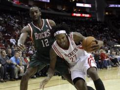 Milwaukee Bucks forward Luc Richard Mbah a Moute, left, has made himself into an impactful defensive player and thus more valuable as a restricted free agent.