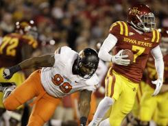 Iowa State wideout Darius Reynolds avoids Oklahoma State defensive end Richetti Jones on Nov. 18. The Cowboys let a 24-7 lead slip away and suffered a 37-31 overtime defeat.