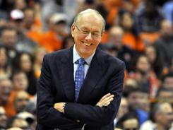 Syracuse head coach Jim Boeheim has a laugh during the second half against Eastern Michigan in an NCAA college basketball game in Syracuse, N.Y., Tuesday, Nov. 29, 2011.