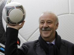 Spain's coach Vicente del Bosque unveils the official ball of Euro 2012 prior to the final draw Friday in Kiev, Ukraine.