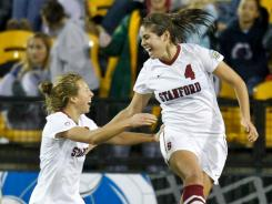 Stanford Cardinal defender Alina Garciamendez celebrates with teammate Camille Levin after scoring a goal against the Florida State Seminoles during the second half of their NCAA semifinal match on Friday.