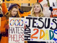 Demonstrators gather outside the Carrier Dome prior the men's basketball game between Syracuse and Florida on Friday.