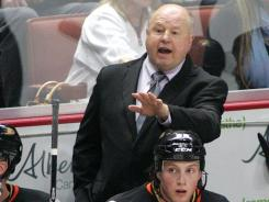 Bruce Boudreau's Ducks lost his first game as coach, as the Flyers overcame a 3-0 deficit, winning on Claude Giroux's power-play goal in overtime.
