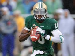 Robert Griffin III threw two TDs and ran for two more to cap Baylor's best regular season in 25 years.