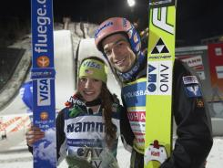 Sarah Hendrickson of U.S. and the men's winner Andreas Kofler celebrate after the FIS World Cup Ski Jumping event in Lillehammer, Norway.