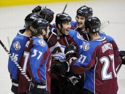 Avalanche players celebrate after Ryan O'Reilly (37) scored an empty-net goal with 34 seconds remaining. The goal was O'Reilly's second of the game.