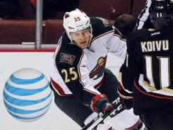 Nick Johnson, left, scored with 5:31 remaining to give the Wild a 4-3 lead they wouldn't relinquish.