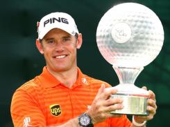 Lee Westwood of England poses with the trophy after winning the Nedbank Golf Challenge on Sunday.