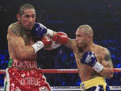 Miguel Cotto, right, earned a punishing measure of payback for his loss to Antonio Margarito three years ago as he retained his 154-pound title.