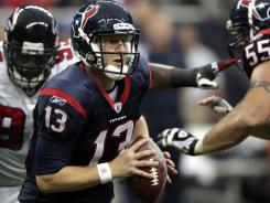 Texans quarterback T.J. Yates scrambles as he looks for a receiver in the second quarter of their win Sunday against the Falcons,