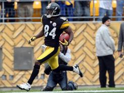 Antonio Brown of the Steelers  returns a punt for a touchdown against the Bengals during the first half of Sunday's game at Heinz Field.