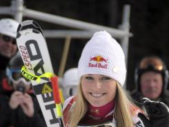 Lindsey Vonn waves after winning a  World Cup women's downhill on Dec. 2 , in Lake Louise, Canada.  Vonn would go on to win two more races this weekend.