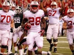 Wisconsin running back Montee Ball had four touchdowns, including the go-ahead score with under four minutes left.